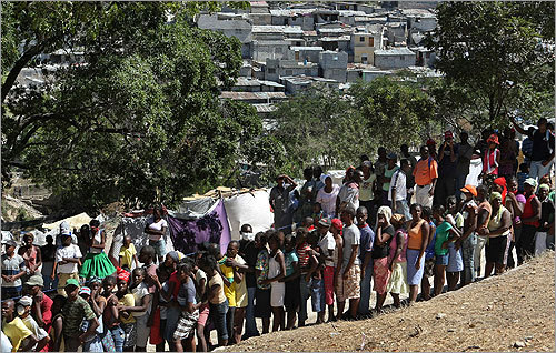 A line of some 40,000 to 50,000 people lined up to collect food on a hilltop at the Petionville Golf Course in Haiti. More than two weeks after the 7.0-magnitude quake devastated the country's capital of Port-au-Prince, many survivors still struggle to find food.