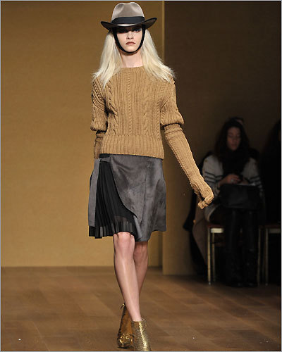 TREND THAT WILL MAKE WOMEN COMFORTABLE THIS FALL: Thick, warm, and forgiving, cable knit sweaters showed up everywhere this week on runways from Michael Kors to Derek Lam. Pictured: Chunky sweater and skirt combination by Derek Lam.