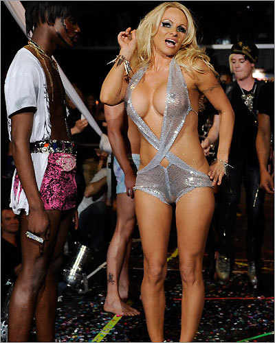 WORST OVER-THE-TOP FASHION PRESENTATION: Former Heatherette designer Richie Rich teamed with Pamela Anderson for yet another tacky, glittery extravaganza (pictured). It seems as if Rich has fallen into a rut, and even worse, the show started nearly an hour late. We stayed late for this? BEST OVER-THE-TOP FASHION PRESENTATION: More than 70 models showed Moncler's new Grenoble line while standing on several stories of scaffolding at the 59th Street Piers Golf Club. The European jacket company thought of everything, including offering thermoses filled with hot chocolate and mulled cider to guests who stood outside in the cold to view the collection.