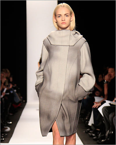 BEST VISION OF FASHION'S FUTURE: We can only hope that the minimalist creations of Narciso Rodriguez someday become reality. His sparse, primarily black collection stripped away the unnecessary trappings of fashion, leaving nothing but future filled with sleek dresses, and helmet-like hats. Pictured: An outfit from the Narciso Rodriguez collection.