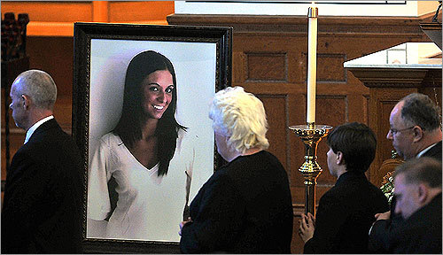 Mourners filed past a large portrait of Britney Gengel during her funeral mass at St. John's Catholic Church in Worcester Saturday.