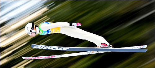 Martin Schmitt helped Germany to a ski jumping silver medal.