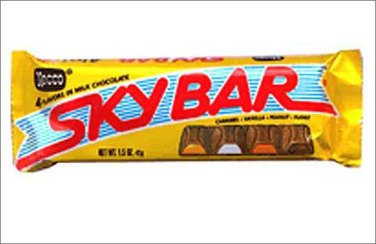 Sky Bar This Necco original debuted in 1938, and features four different flavors - fudge, caramel, peanut and vanilla nougat - embedded in the chocolate. The company touts it as the first and only four-flavored candy bar.