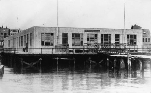A waterfront view of the immigration station circa 1922.