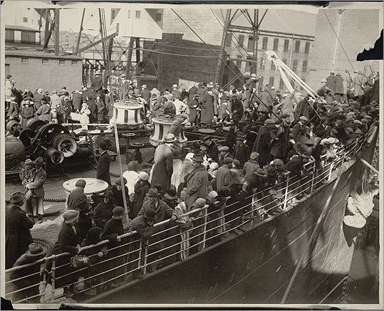 The S.S. Carmania arriving with immigrants from Eastern Europe in 1923, docking in East Boston.