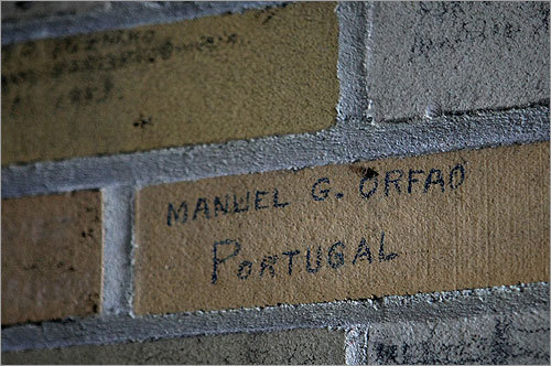 Names of people and where they came from before entering Boston remain scrawled on the walls inside the dilapidated building.