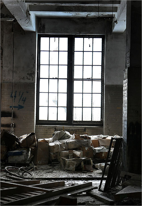 A view of a window amid rubble.
