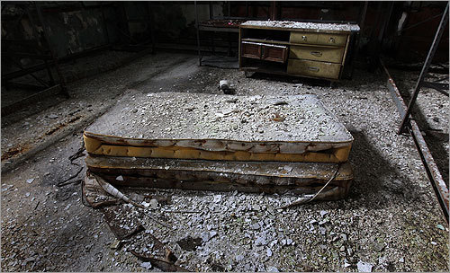 An old mattress amid the debris inside the building.