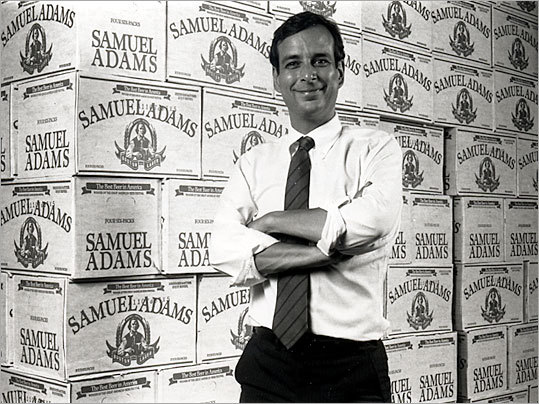 When Jim Koch started selling Samuel Adams Boston Lager on Patriots Day in 1985, he didn't have enough money to distribute the beer in kegs or six packs, so he sold it in cases of loose bottles, the first batches of which were brewed in his kitchen. Now, it has become is one of the largest American-owned beer companies. Click through to read about the history of the Boston brewer. Left: Koch is shown here posing in front of cases of Boston Lager in 1985.