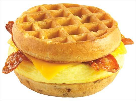 Dunkin' Donuts Waffle Sandwich In the spirit of the McDonald's McGriddle, Dunkin' Donuts began offering a breakfast sandwich with a syrup-infused waffle bun in early 2009. The sandwich returned in 2010. Do you prefer the McGriddle or the waffle sandwich? customer surveys