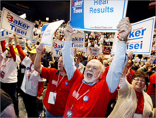 John Carlson, center, his wife Nancy, right, and his son Mark, third from right, all of Grafton, Mass., cheered for Baker during the nomination process.