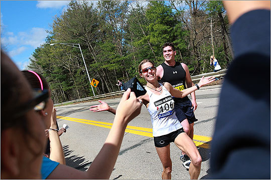 A runner reacted to the spectators in Wellesley with a smile and a friendly hand.