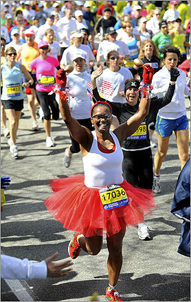 This woman sported a bright red tutu and a friendly smile as she ran the marathon.