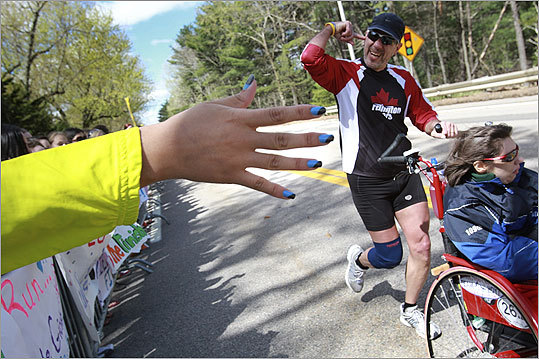 A spectator in Wellesley held out a very colorful manicured hand to high five marathon participants.