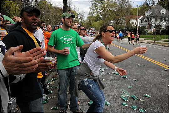 Members of the Boston Hash House Harriers running club offered free beer to runners at Heartbreak Hill.