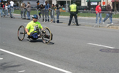 A wheelchair competitor approached the final mile marker in the race.