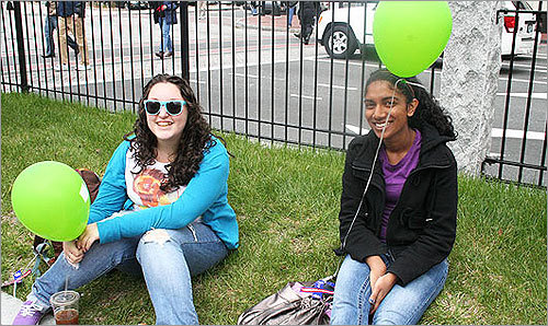 Boston University students Rachel Tesler and Liz Mathew watched the runners from a grassy patch along the route. 'It would be cool to actually do the Boston Marathon one day,' Mathew said.