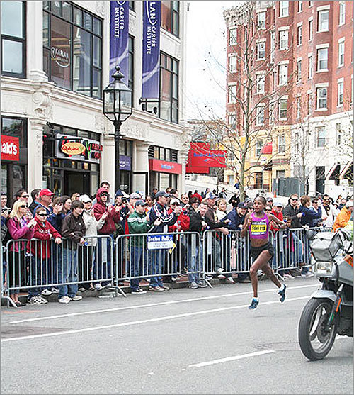 The crowd cheered as Teyba Erkesso ran into Kenmore Square.