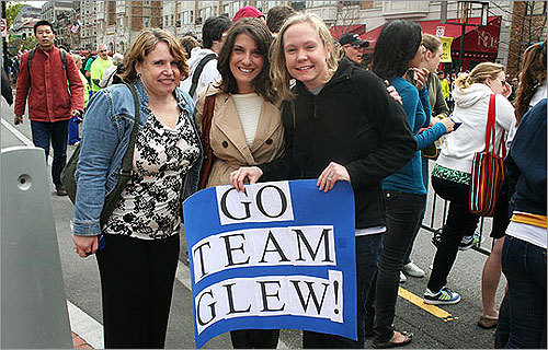 Nancy Spafford of Cambridge, Jennifer Gibbs of Amherst, and Dana Reese of Waltham made a sign to cheer on Nicki Glew in her first Boston Marathon.