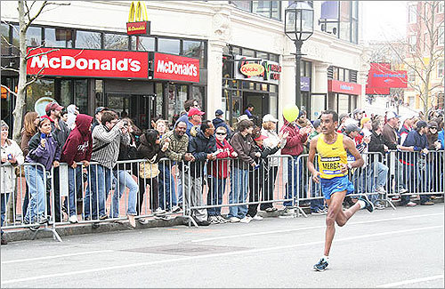 Ethiopia's Deriba Merga dashed by the loud crowd in Kenmore Square.