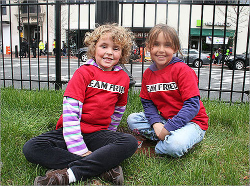 Olivia, 5, and Katie, 7, of Arlington, Va., played UNO while they waited for their dad, Greg, to arrive. The girls wore shirts that said Team Fried on the front and 'I Heart Dad' and 'Dad's #1 Fan' on the back. Although it was Greg's first Boston Marathon, he has run 20 other marathons.