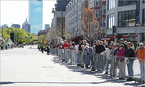 Spectators in Kenmore Square awaited the arrival of the first finishers in the Boston Marathon.