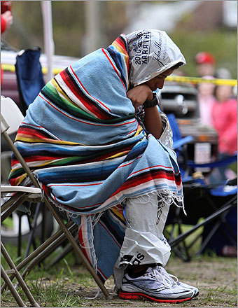 Wrapped in a colorful blanket, Victor Ornelas of Durham, North Carolina sat dejected at medical station on Heartbreak Hill during the race. He later rejoined the race.