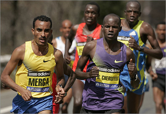 Deriba Merga, of Ethiopia, (left) and Robert Cheruiyot, of Kenya, (right) led the pack in Natick.