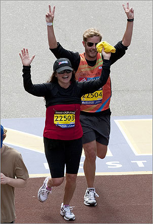 Actress Valerie Bertinelli waved her arms as she crossed the finish line at 5:22:39.