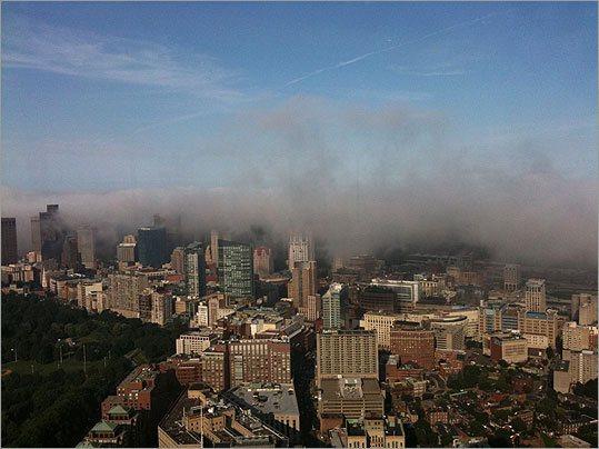Louis Rivers took this photo of the foggy city from the John Hancock building in August 2009.