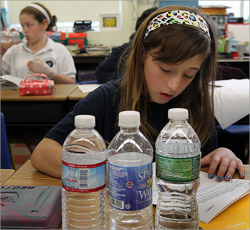 Students at the Eliot Elementary School in the North End of Boston had to drink bottled water. Seated in her 5th grade math class with 3 bottles of water is Ciara D'Amico.