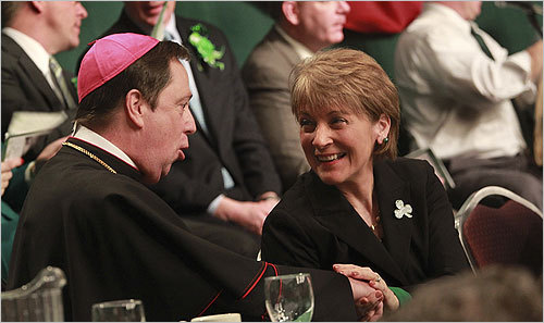 Coakley spoke with Bishop Robert F. Hennessey, during the annual St. Patrick's Day breakfast.