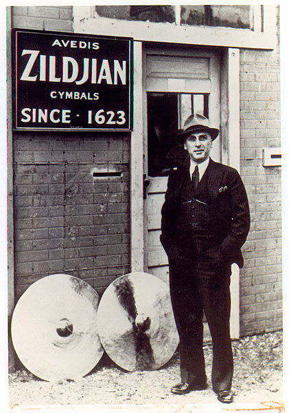 Avedis Zildjian Co. Founded: 1623 Industry: Musical Instruments Location: Norwell The cymbal dynasty goes back to the early 17th century, in Constantinople. It began with Avedis Zildjian I, who stumbled upon a new way of creating alloys in 1618. He had been trying to create gold by combining base metals, but ended up with an alloy of copper, tin, and traces of silver, which was great for making cymbals. The secret formula has since been taught and passed on through the generations. Pictured here, Avedis Zildjian III in front of the original factory in Quincy in the early 1930s.