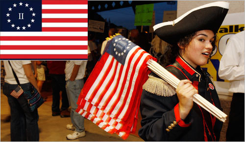 In 2009, a laid-off Michigan auto-parts marketer designed the Flag of the Second American Revolution, now widely flown at Tea Party rallies. Samantha Johnson of Phoenix carried several miniature flags during a Tea Party Tax Day rally in Tempe, Ariz.