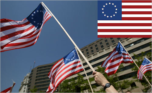 The Betsy Ross flag evokes Revolutionary-era patriotism, though the actual connection to Ross isn't clear. People held the Ross flags while participating in a Tea Party Protest in Freedom Plaza in Washington, D.C.