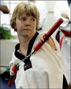 Sheila Radziewicz of Salem used her nunchucks during taekwondo class at Bruce McCorry's Martial Arts Studio in Peabody. (AP Photo/Salem News, Mark Lorenz)