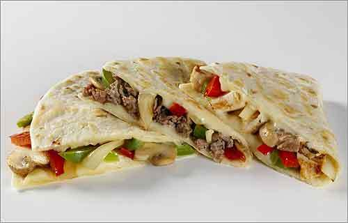 D'Angelo Sandwich Shop Number 9, Chicken Stir Fry and Classic Vegetable Grilled Quesadillas Calories: 280-370 Calories from fat: 120-170 Sodium (mg): 810-1050 Sugars (g): 3-5 Right: Classic Vegetable, Number 9 and Chicken Stir Fry Grilled Quesadillas Price: About $3