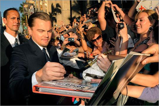 Leonardo DiCaprio signs autographs
