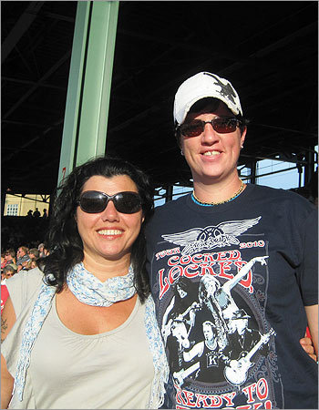 From left: Janice Maloof, of Marshfield, with friend Sarah at Fenway. 'I have seen both bands over 15 times and they are still incredible!' she writes.