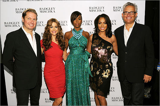 From left: Designer James Mischka, Denise Richards, Kelly Rowland, LaLa Vazquez, and designer Mark Badgley backstage at the Badgley Mischka Spring 2011 fashion show on Sept. 14.