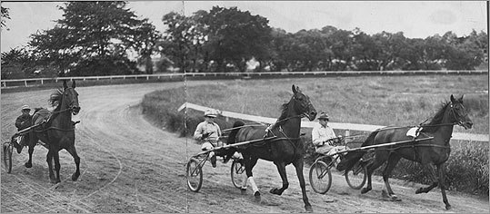 In this 1951 photo, three drivers of the Metropolitan Driving Club of Boston exercised their horses at the speedway.