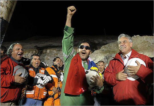 The last miner to be rescued, Luis Urzua, 54, celebrated as Chilean President Sebastian Pinera, right, looked on.