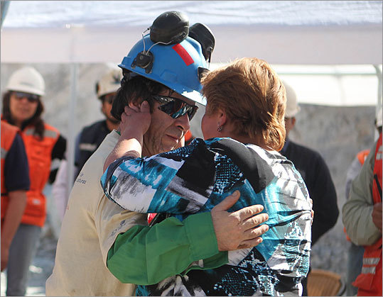 Johnny Barrios Rojas embraced his mistress Susana Valenzuela after being rescued. Rojas's wife was not at the mine to greet her husband. (Hugo Infante, Government of Chile/ AP Photo)