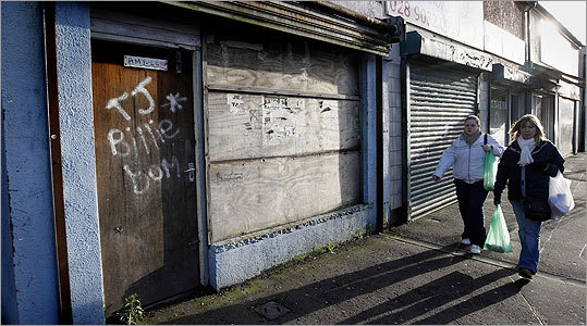 Boarded up shops are seen on Sandy Row, Belfast, Northern Ireland. The British economy has officially sunk into recession, government statistics showed Friday, with output falling 1.5 percent in the fourth quarter of last year as the financial crisis ravaged banks, retail and manufacturing.