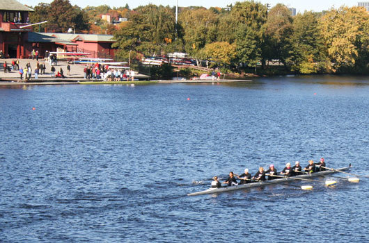 The women of the Naiades Oncology Rowing, Inc., competing in the Senior-Master Eights, swept past the Newell Boat House.