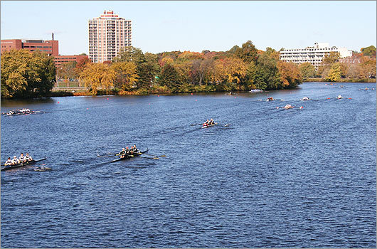 A slew of racers rounded a bend in the Charles.