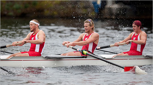 Rowers from the University of Wisconsin plowed down the river.