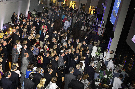 Oct. 21 in Boston The International Rett Syndrome Foundation's 10th Annual Festival of Food and Wine, held at the State Room, garnered more than 500 guests and raised over $500,000. Pictured: guests watched a video during the event.