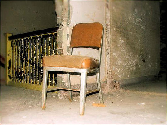An empty chair and stairwell at Foxborough State Hospital.