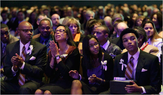 The Henry family took in the service held at the Boston Convention & Exhibition Center.